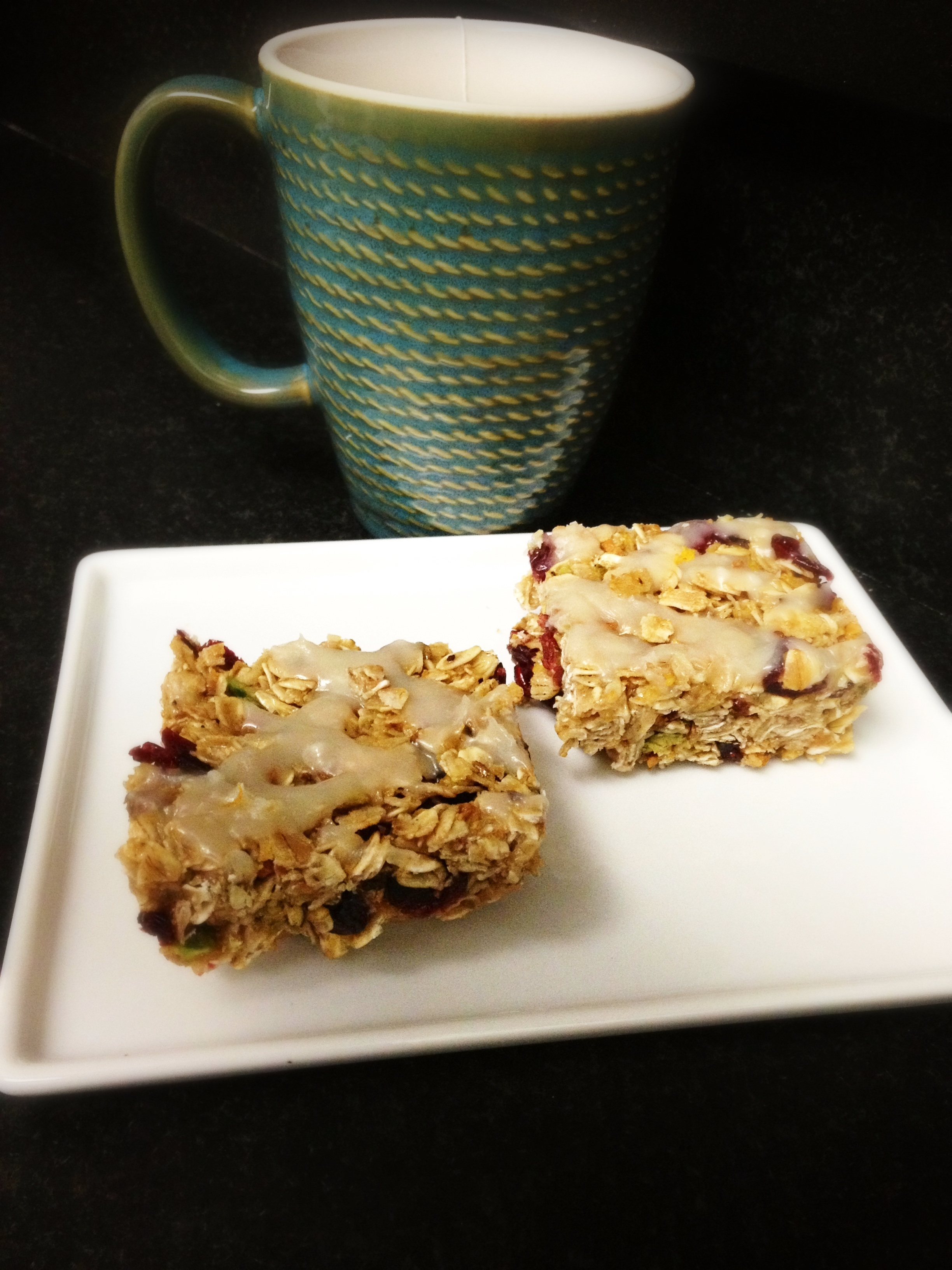 Pistachio Orange Cranberry Granola Bars with Greek Yogurt Drizzle