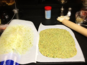 Pistachio dough rolled between two pieces of parchment paper